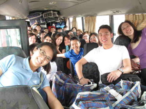 H Zone happily crammed on the bus with bags of clothing and food supplies for the kids.