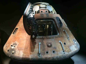 The Apollo 13 module after its safe return - the brown exterior is due to the metal being burnt on re-entry to Earth.