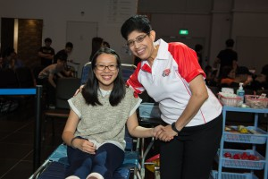 Marine Parade GRC MP Fatimah Lateef, with a youth donor