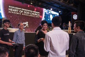 Minister of Parliament Associate Prof Fatimah Lateef presenting scholarships at the Heart of God Church (Singapore) Academic Excellence Weekend
